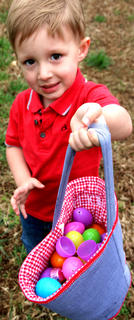 Aiden James Spalding, 2, proudly shows off all the eggs he found during Saturday morning's Easter egg hunt at Graham Memorial Park in Lebanon. Spalding is the son of Dylan Spalding and Ashley Auberry.