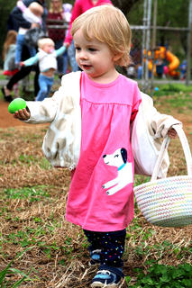 Anita Hennen, 2, isn't quite sure what to do with this bright green Easter egg she found.