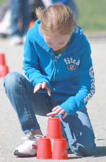 Alexis Hamilton of West Marion Elementary makes sure her cups are steady before running to the next station.