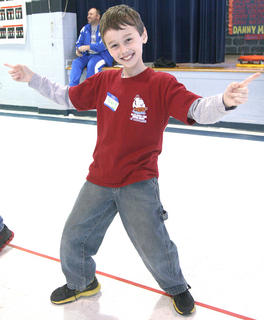 Parker Blair of West Marion Elementary does a victory dance after his team won a relay race.