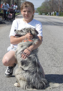Sarah Barnes takes a quick break to love on her dog, Blue.