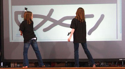 "Fourth-graders Josie Followell, left, and Aubrey Mealey follow the Rolling Stones' lead and  ""Paint It Black."""