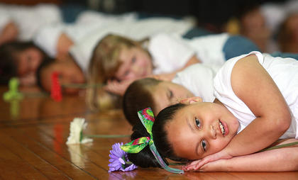 Lakin Sickles, Landon Hyatt and Kellie Cox weren't taking a nap. They were performing part of the first graders' dance routine.