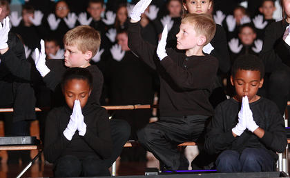 """The third graders perform to """"Hands"""" by Jewell. Imani Biggers and Cory Hall are in the front row. Nicholas Martin and Parker Barnett are in the second row, and Maggie Wright is at the top."""