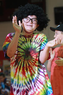 Mariella Curtis is clearly having fun performing the evolution of the fifth grade (a routine inspired by the evolution of dance).