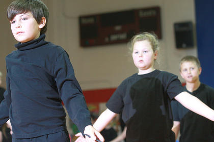 Fourth graders Eli Thomas, Morgan Garrett and Ryan Lee Hayes perform their routine.