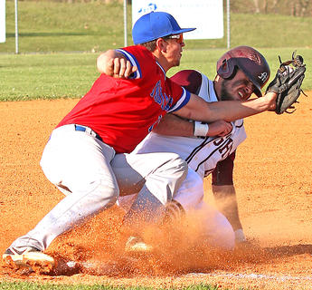 Travis Wiser slides into third base in Marion County's 8-1 loss to Adair County on April 17 at Dave Hourigan Field.