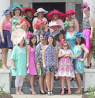 The models for Saturday's fashion show gather for a group photo on the front steps of Myrtledene.
