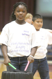 "Glasscock Elementary School held its annual student showcase April 23 at Marion County High School. This year's program was built around the seven habits emphasized in The Leader in Me program. Fourth-grader Kentasia Spalding plays the drum during a routine to ""I Lived"" by One Republic."