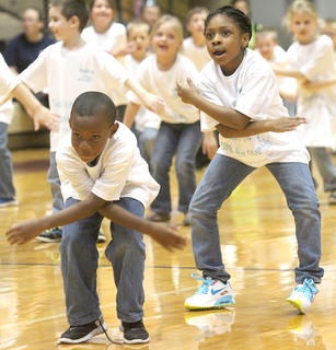 "JayTavion Cowherd and CorNya Hillard stay loose for the closing of the first-graders' performance of ""Lean on Me"" by Club Nouveau."