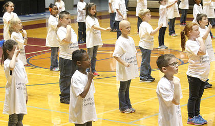 "Second-graders Trinity Votaw, Amayan Owens, Eli Murphy Orberson. Vanessa VanWhy, Charles Irvin, Cathy Holliday, Elizabeth Holliday. Mia Mattingly, Jakyla Thornton, Gracey Loudenburg, Jaxson Hibbard and Ben Thomas join in the routine that accompanies ""Hold My Hand"" by Akon and Michael Jackson."