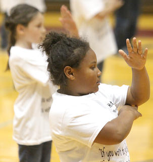 Second-grader Deazarae Washington performs a choreographed series of movements.
