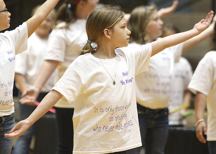 "Laura Thomas, a fourth grader, dances as part of a routine to ""I Lived"" by One Republic."