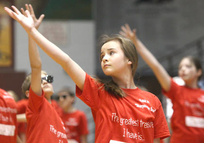 "Abi Adams adds a little flourish to the fifth-graders dance to ""Firework"" by Katy Perry."