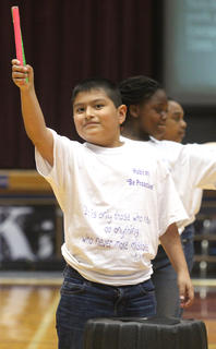 "Fourth-grader Noe Serrano plays the drum during a routine to ""I Lived"" by One Republic."