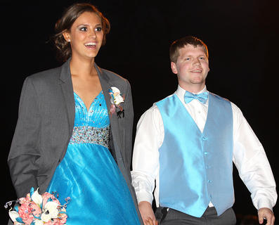 Shelby Goode looks startled by the hug crowd gathered at Centre Square as she and her date, Jared Tutt, make their grand entrance.