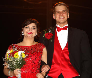 Macy Tungate and Anthony Ballard look smashing in their red as they walk into prom.