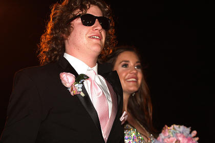 Simon Smith is too cool in his cheap sunglasses as he and his date, Macy Bradshaw, walk into Centre Square.