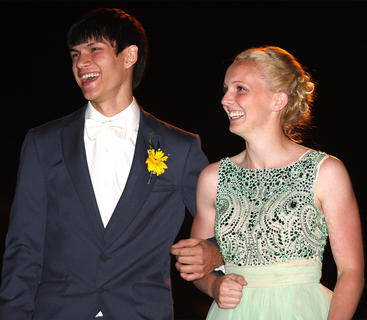 Luke Price and Miranda Bradshaw laugh with the crowd as they pose for a photo.
