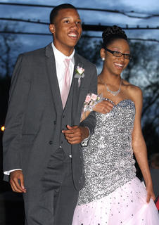 Latrelle Irvin and Jabiesha Durham are all smiles as they make their grand entrance into the prom.