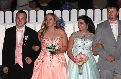 Brittany Jones (peach dress) and Tyler Jones (far right), along with their dates, arrived at prom on a decorated wagon.