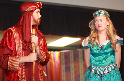 The day before she is to wed, Princess Jasmine (Carly Mattingly) shows the sultan (Ethan Higdon) that she is not impressed with her suitors.