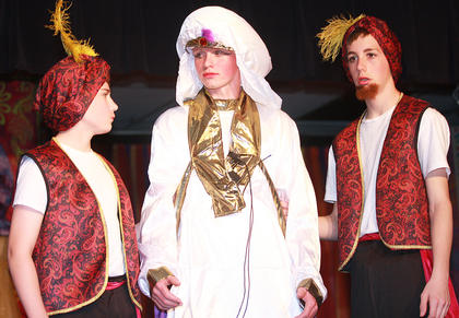 The palace guards (Evan Brady, left, and Nicholas O'Daniel) attempt to capture Aladdin (Luke Jones) in disguise as Prince Ali Ababwa.