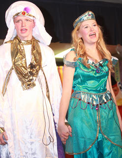 After Jafar is tricked into turning himself into a genie, Aladdin (Luke Jones) and Princess Jasmine (Carly Mattingly) are able to marry.