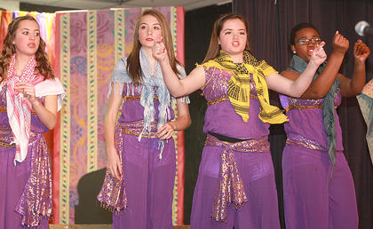The townspeople (from left, Amelia Smith, Audrey Mays, Paige Mattingly and Arieyon Smith) provide the narration for the story.