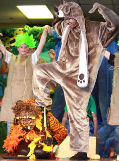 Baloo (Jared Tutt) celebrates after he and the rest of the jungle successfully stop Shere Khan (Abby George).