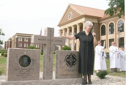 Sr. Mary Lois Speaks explains the different images on the memorial commemorating the Ursuline Sisters of Mt. St. Joseph for 100 years of service in Marion County.