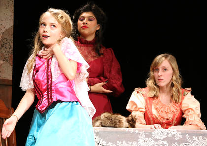 Cinderella's evil stepsister Grace, played by Elizabeth Morris, explains why she is the perfect woman for Prince Charming. Also pictured are Cinderella's evil stepmother, played by Andy O'Daniel, and her second evil stepsister, Joy, played by Gracie Wilson.