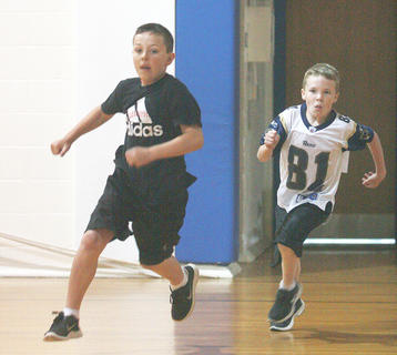 To get in the spirit of the Kentucky Derby, physical education classes at Glasscock Elementary School held their own races last week. Third-graders Clayton Coulter and Blake Wethington make the turn for the home stretch.