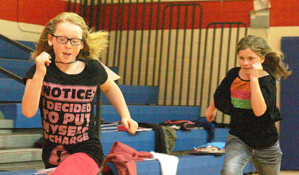 Loryn Hardin holds off Emily Tungate is a fourth-grade race.