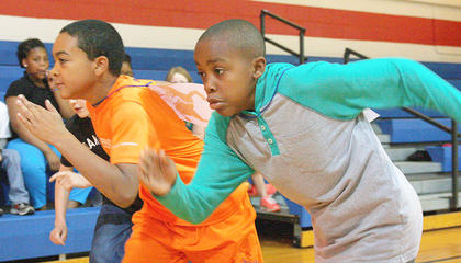 Fourth-graders Omarrion Burch and Javon Adams are off to a fast start.