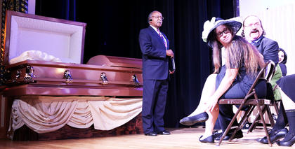 Revered Hooker (Jerry Evans) tries his best to preside over the unruly bunch attending Bud Turpin's (Gene Hall) funeral. Also pictured is Brittany Rye, Kent McAllister and Zoey Blair.