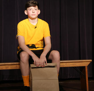 Joe Keith Shewmaker plays the part of Charlie Brown who hates eating lunch alone at school.