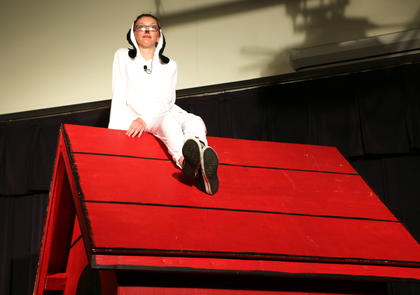 Snoopy (Audrey Thompson) loves spending his days watching the world atop his dog house.