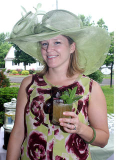 Hostess Wendy Smith enjoys a mint julep as Derby festivities begin.