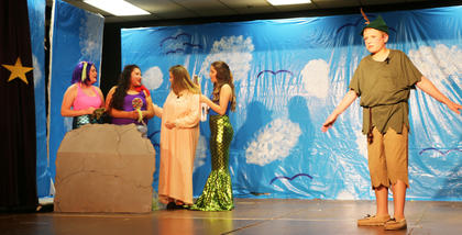 Wendy (Lilly Clark) plays with Neverland mermaids (Abbey Hickey, Johanna Garcia and Allyson Russell), causing Peter Pan (Caden Morgan) to feel jealous.