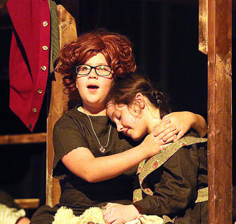 Annie, being played by Brooklyn Richardson, comforts Molly, played by Sarah Blandford, who had a bad dream.St. Charles Middle School partnered with Kentucky Classic Theatre to present Annie Jr. May 5-7, at Angelic Hall in Lebanon. The production will be on stage again at Angelic Hall May 13-14 and May 19-21 with different casts. Tickets are available at the door or in advance at Farmers National Bank, the Lebanon Tourist and Convention Commission or online at mykct.com. Call 270-692-0021 for more information.