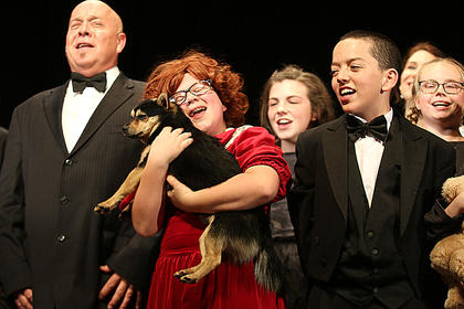 """Pictured, from left, are Van Gadberry, playing the part of Oliver """"Daddy"""" Warbucks, Brooklyn Richardson, playing the part of Annie, Allie Smith as Kate, Samuel Thompson as Drake and Brooklyn Gaddie as an orphan."""