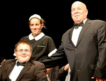 Warbucks, played by Van Gadberry, right, receives a surprise visit from President Roosevelt, played by Zachary Cantrill. Also pictured is Taylor Richardson playing a member of Warbucks' staff.