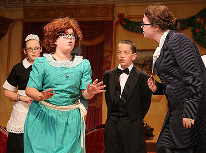 The staff of the Warbucks Mansion welcomes Annie with open arms. Pictured is Brooklyn Richardson as Annie, along with, from left, Rachel Potts as Annette, Samuel Thompson as Drake and Heather Ransdell as Grace Ferrell.