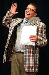 Clayton Tungate plays the part of Bert Healy, a radio announcer who agrees to broadcast Annie's search for her parents.