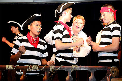 Pictured, from left, are Robert Billeter, Jessy Castillo, Michael Todd and Christian Mealey all playing the part of sailors on Prince Eric's ship.