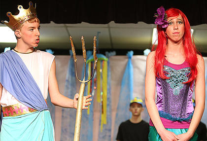 Landon Rakes, left, is King Triton, Ariel's father and ruler of the Sea. Jessica Thomas plays the part Ariel.