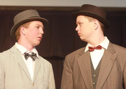The St. Augustine eighth graders performed The Music Man Jr. as its eighth-grade musical on May 6. The play tells the tale of traveling salesman Harry Hill, who arrives in River City, Iowa, with the aim of selling the musical instruments. In the opening scene, a pair of traveling salesmen (Connor Higdon, left, and Ethan Sparks) discuss the impact Harry Hill has had on the way people view them.
