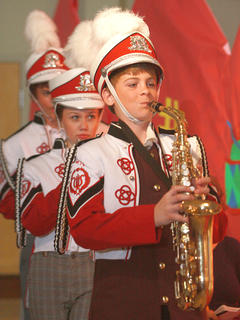 The members of the boys band (front to back, Zachary Hunt, Kaylee Thomas and Luke Thomas) arrive just after the mayor demands to see the what Harry Hill (Aaron Howard) has done.