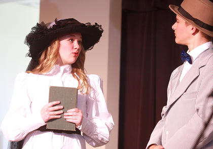 Librarian Marion Paroo (Jane Palagi) lets Harry Hill (Aaron Howard) know that she isn't interested in what he has to say.